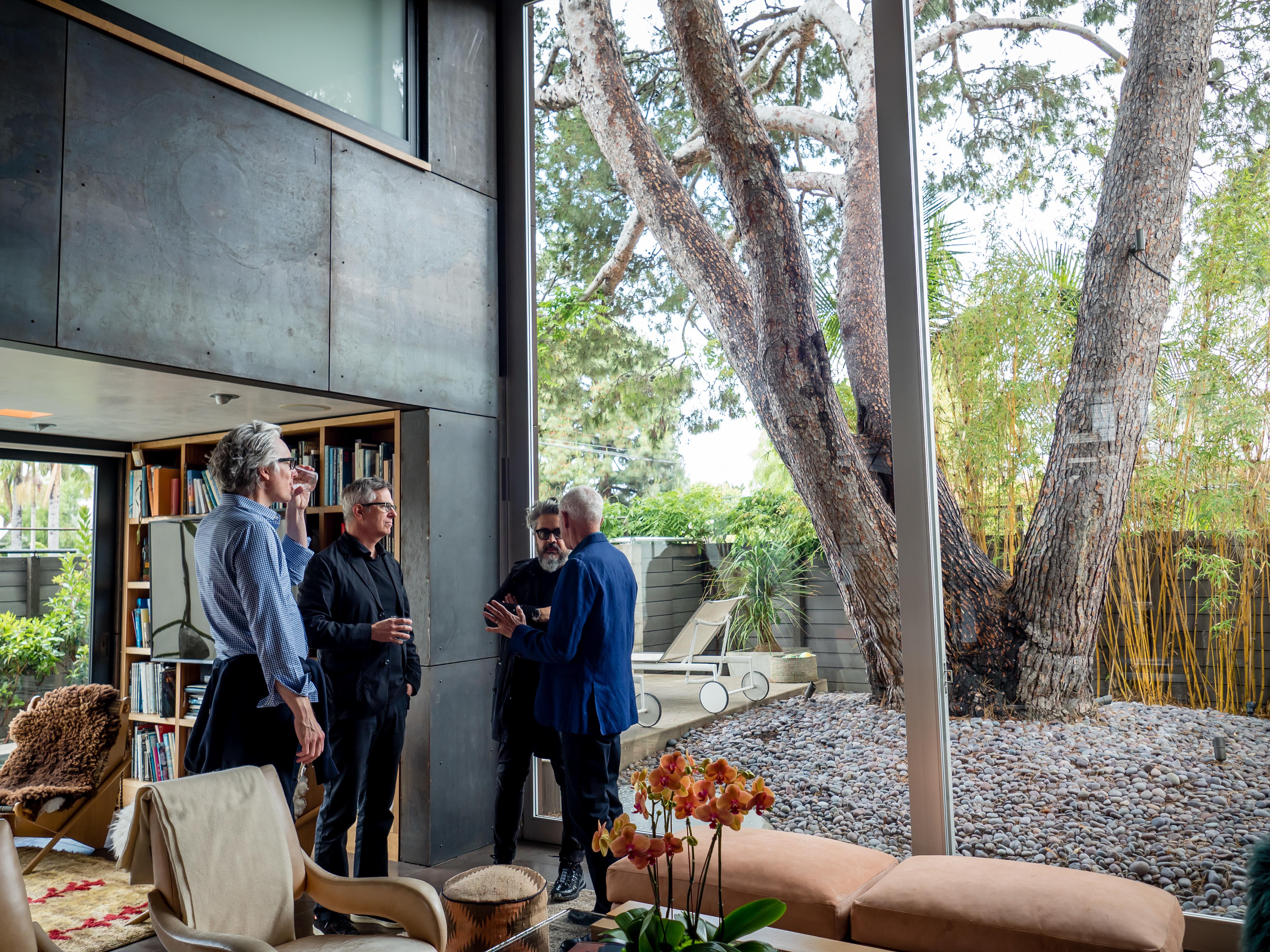 Shelley Kappe 90th birthday celebration male architects talking
