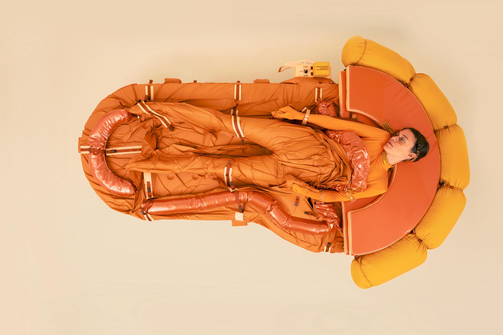 woman orange raft yellow cushions