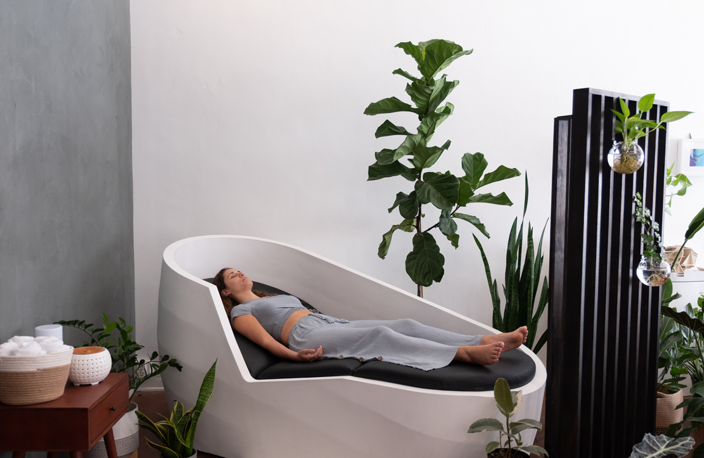 woman reclining round chair plants