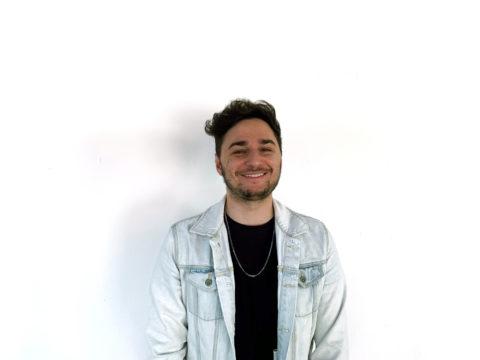 David Eskenazi blue jean jacket white wall