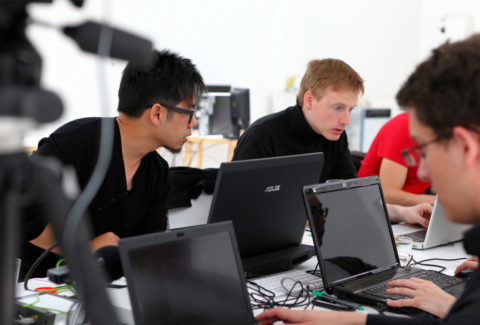 Steven Ma with students in a digital laboratory