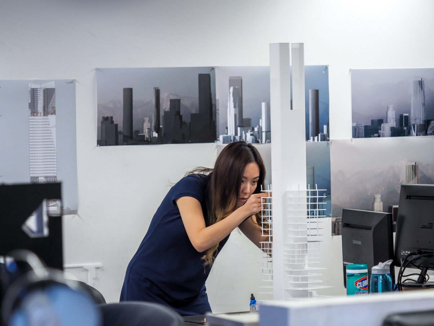 student constructs tall building model in white