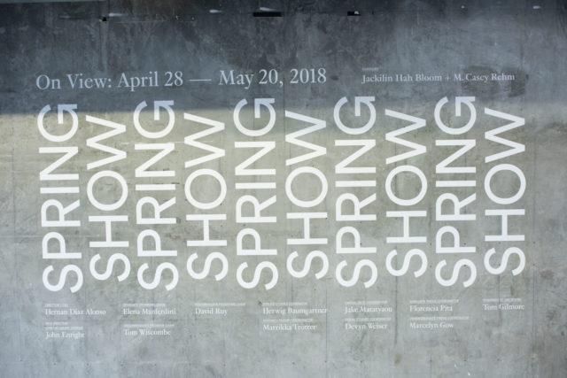 white text on concrete wall spring show 2018