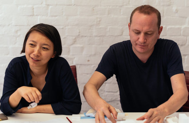 two people sitting at table black shirts
