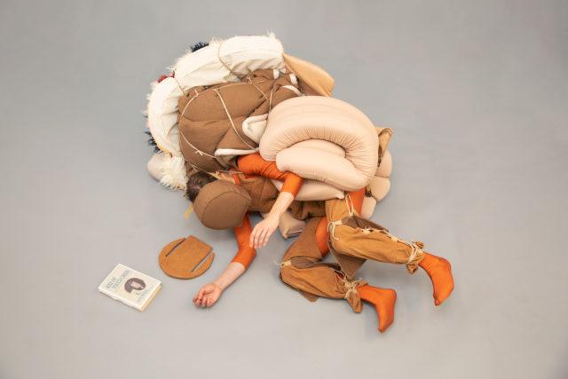 person cushion suit orange tan