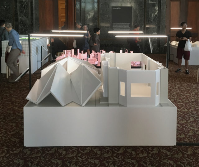 architectural model on low podium carpeted gallery