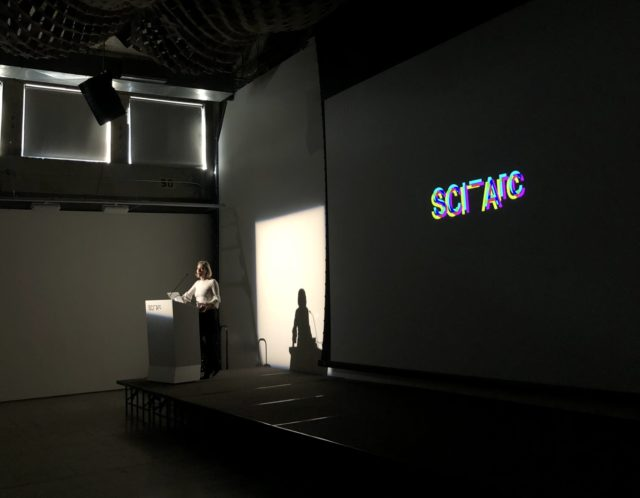 Marrikka Trotter standing at podium presenting
