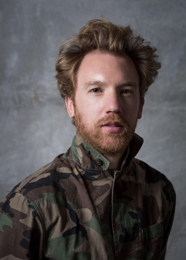 man in camoflauge jacket red hair