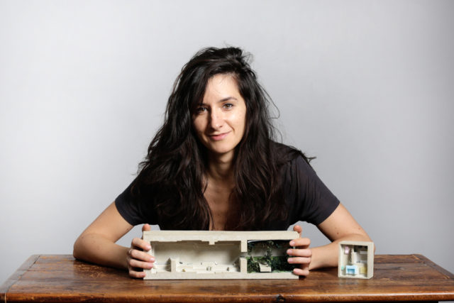 Oana Stanescu, with an architectural model