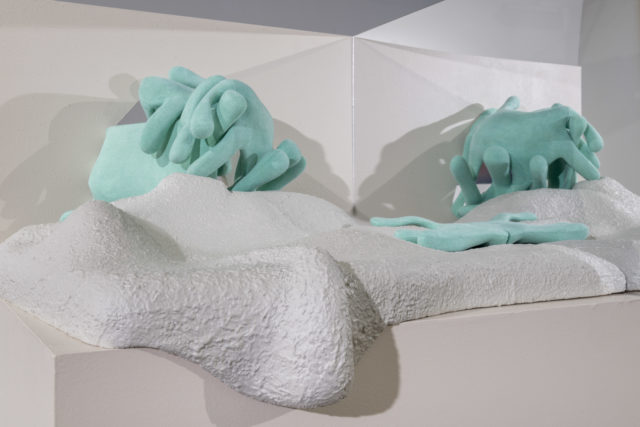 oozing intermingling figures textured in teal and white