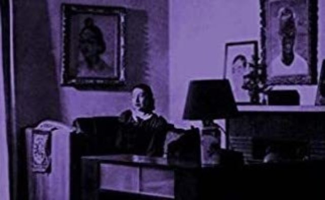 woman sitting in living room purple