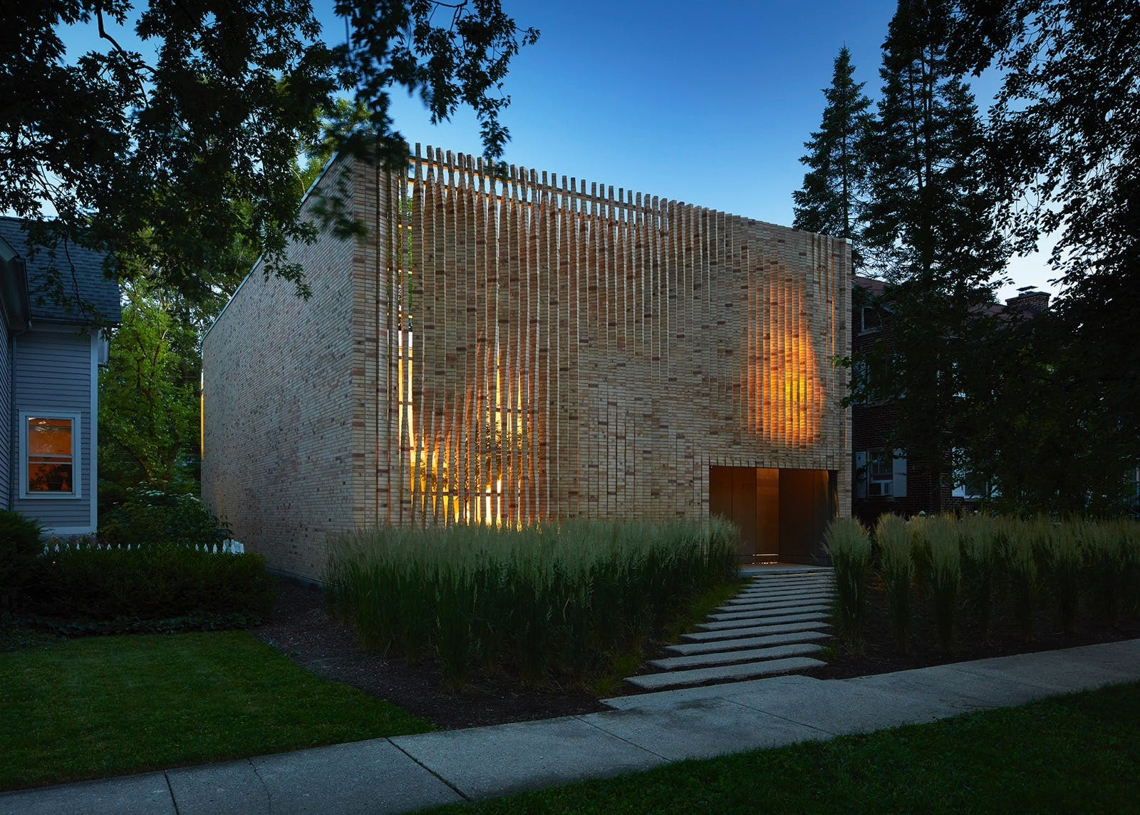 a brick home with brick louvers by Brooks and Scarpa