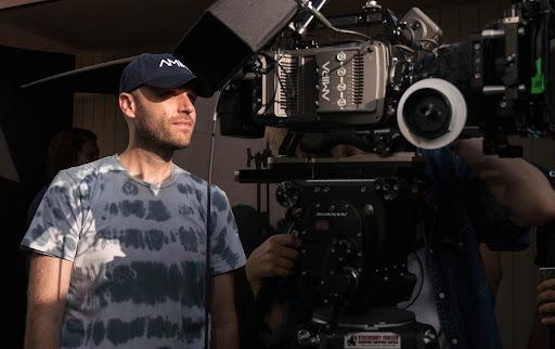 man with film camera