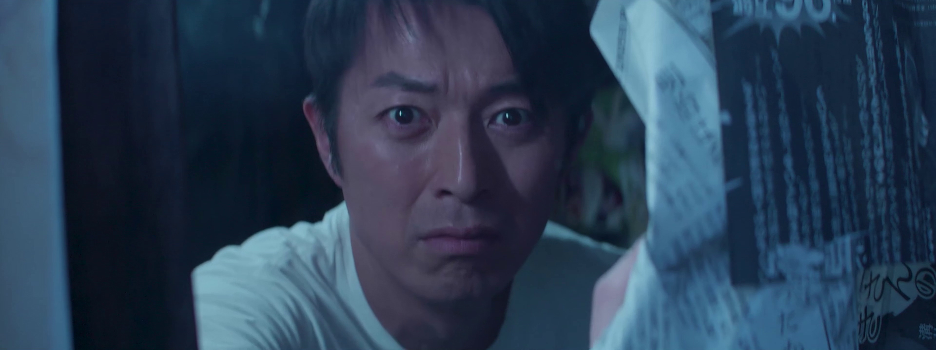 headshot of a Japanese actor scared