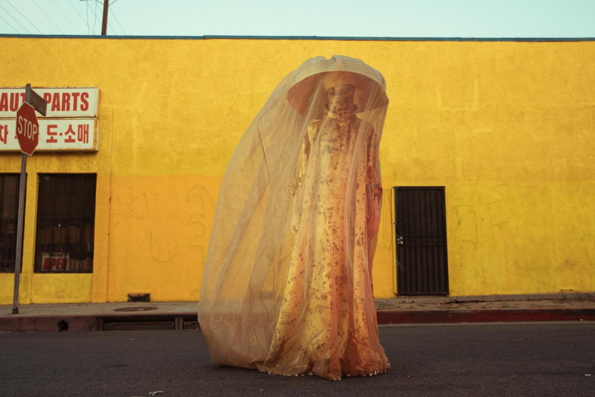 person street yellow umbrella veil