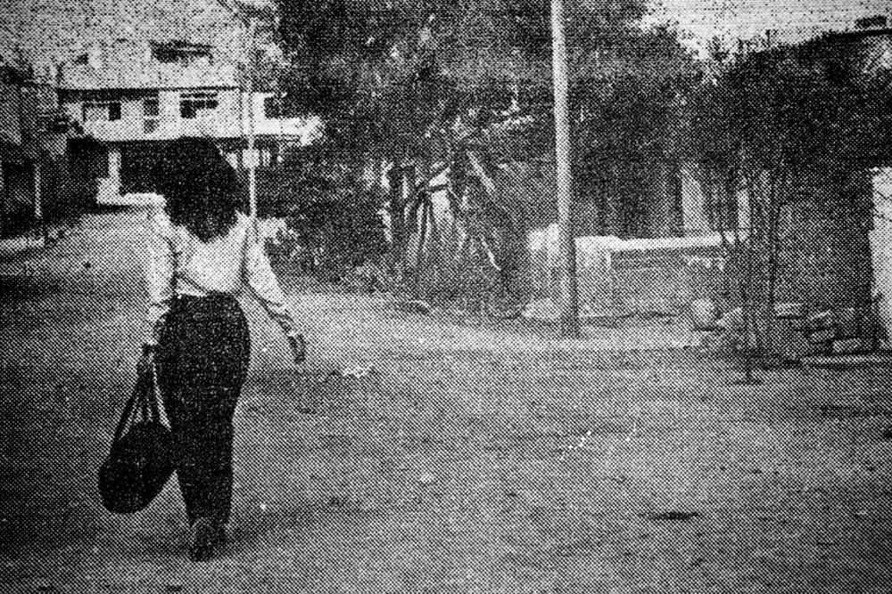 13Krajnak_Woman Walking Bag1