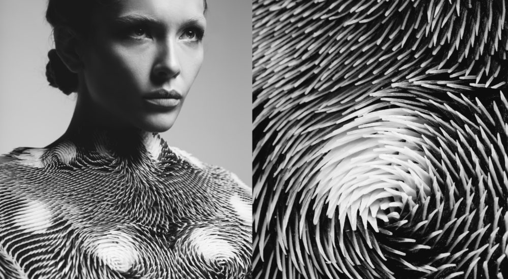 Figure 1: Careess of the Gaze: 3D printed garment, which moves in response to the onlooker's gaze by Behnaz Farahi. Photographer: Elena Kulikov.