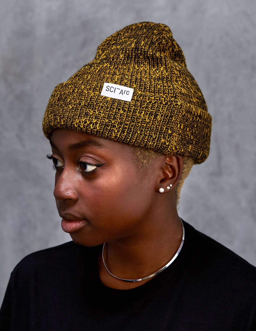 yellow knit sciarc logo beanie on person