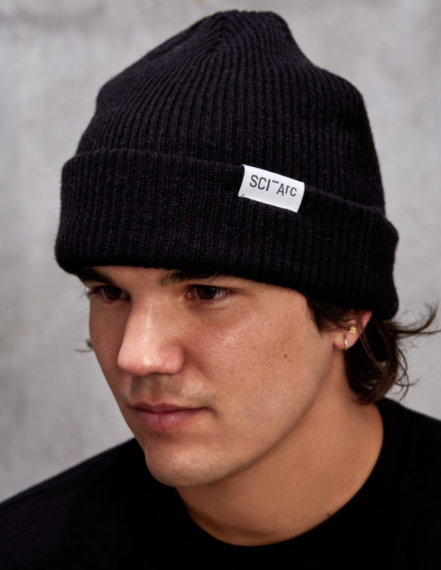 black knit sciarc logo beanie on person