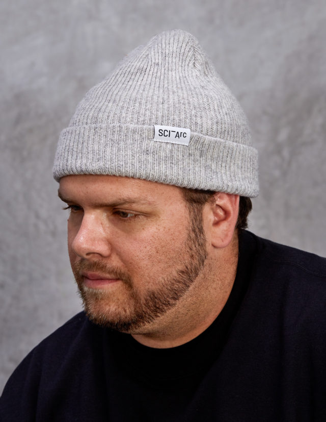 grey knit sciarc logo beanie on person