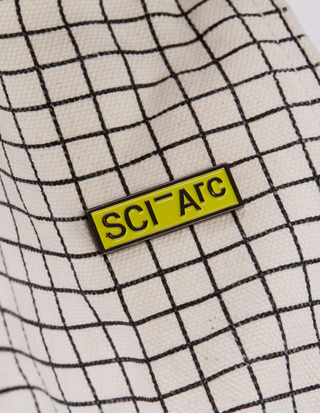sciarc yellow enamel pin on fabric