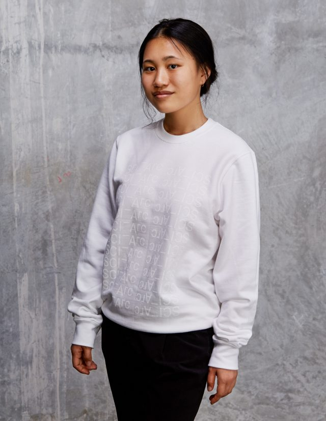 white on white sciarc logo crewneck sweater on female