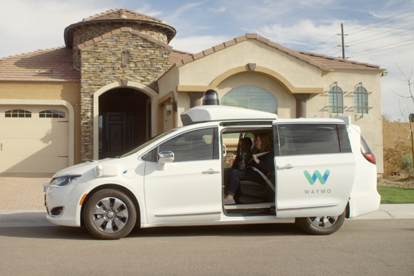 Waymo's early riders approaching an autonomously driven car