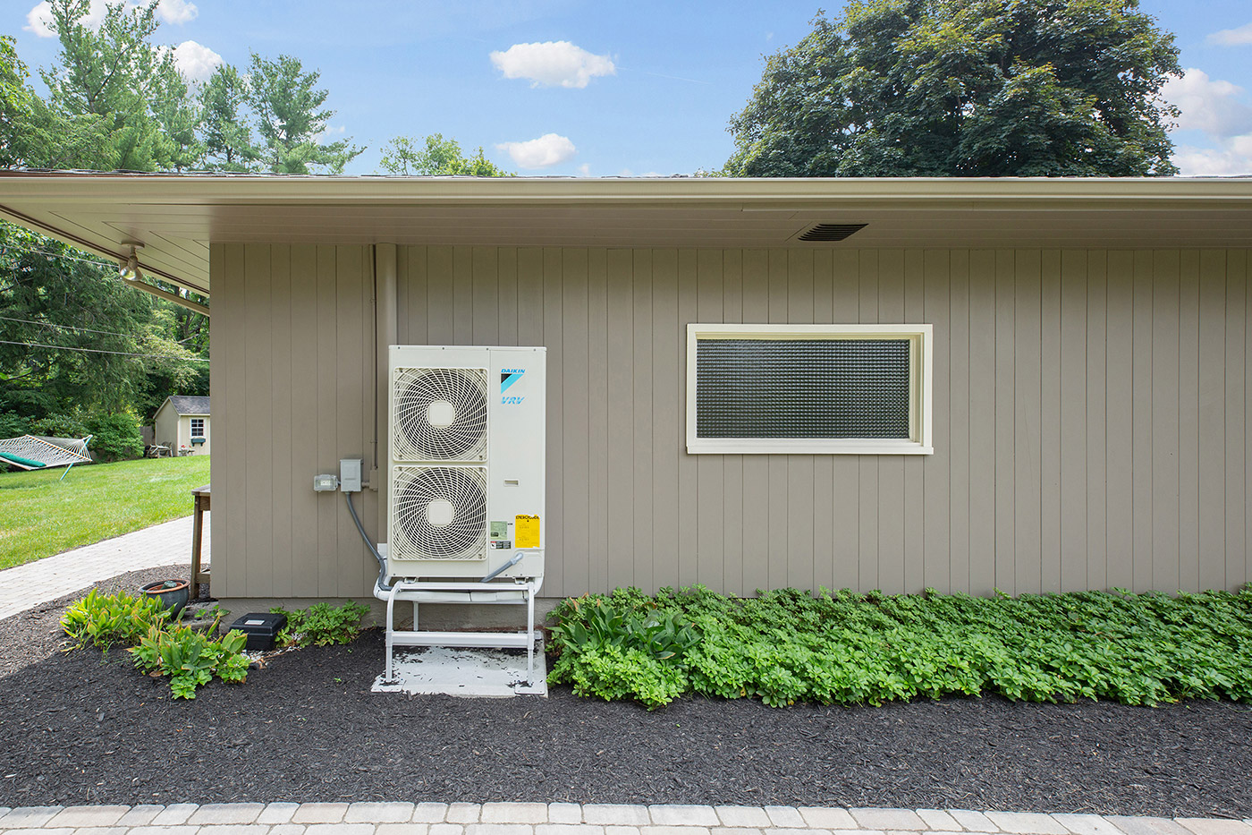Imaage of heat pump outside of a house