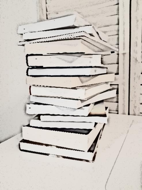 Kirjoja pinossa lattialla.