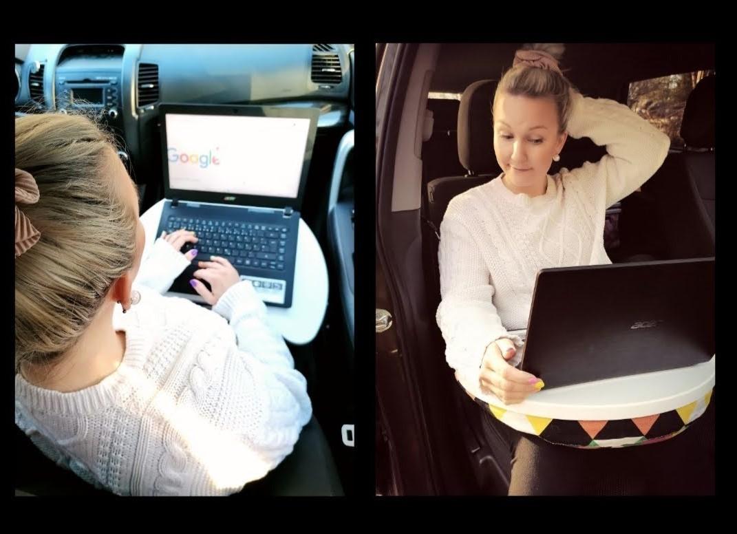 Nainen autossa matkustajana kannettava tietokone sylissään.