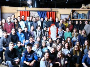 A group of students meeting Santa Claus in the Santa Claus Village in Lapland.