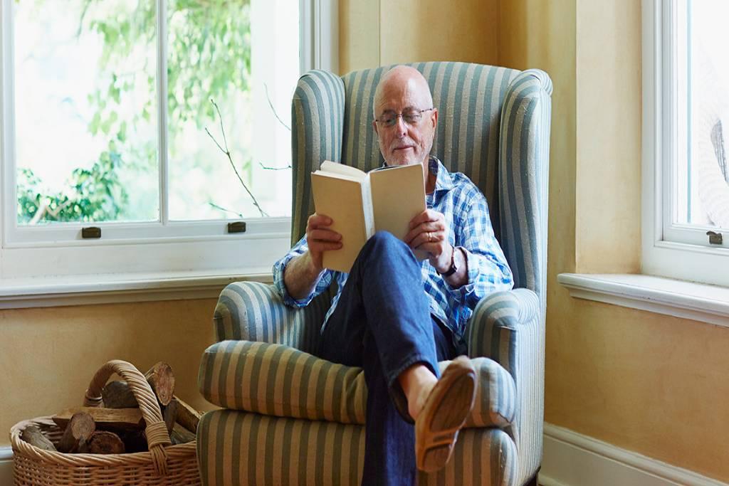 senior man reading in a chair