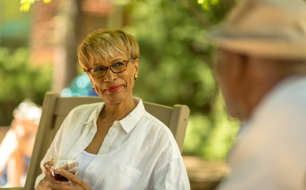 Senior woman talking with someone outside her retirement community