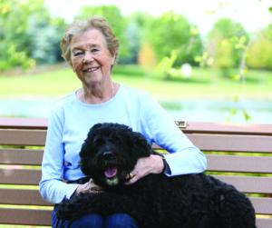 Senior woman with pet at pet-friendly retirement community