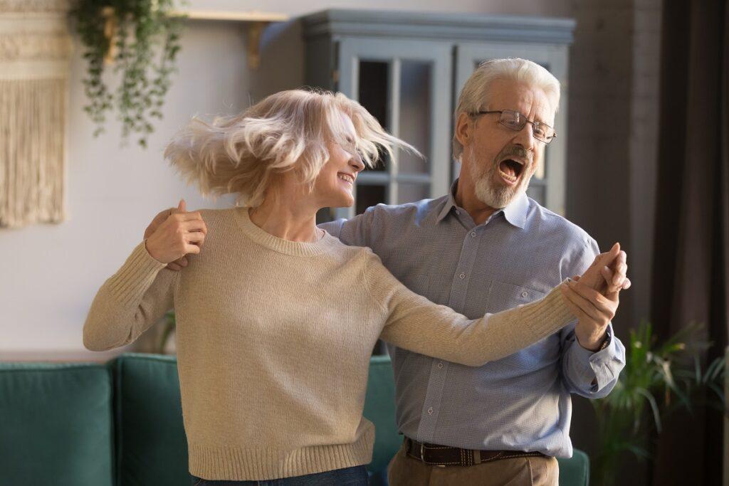 Senior couple dancing indoors