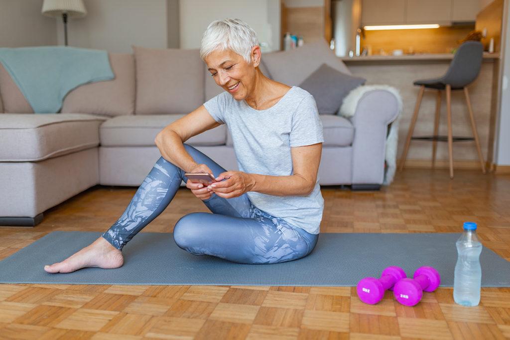 Senior woman doing yoga in her apartment