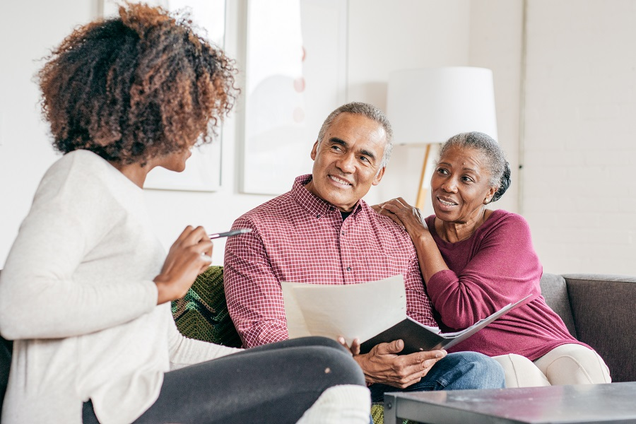 Senior couple getting professional consultation at home