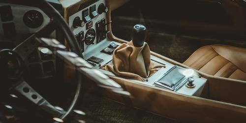 interior of a car with tan leather seats and a manual gear stick