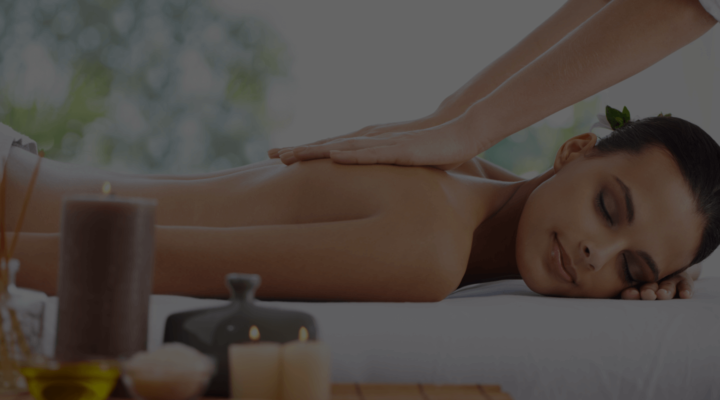 A lady lying down in spa for massage