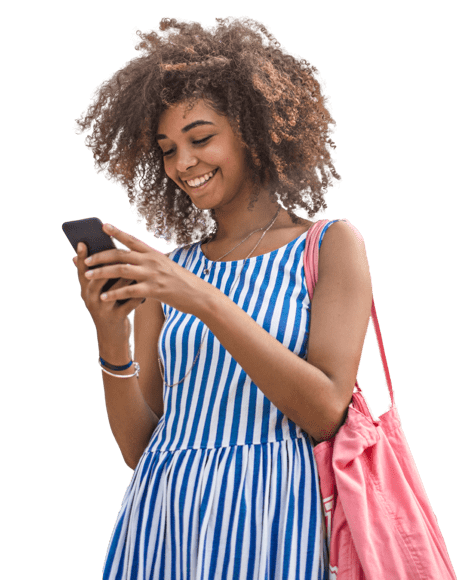 curly haired lady smiling at phone