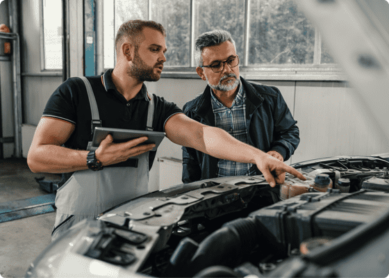 Mechanic explaining details to a customer