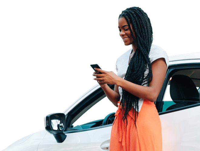 A lady with dreadlocks looking at mobile