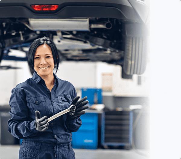 women mechanic holding a spanner