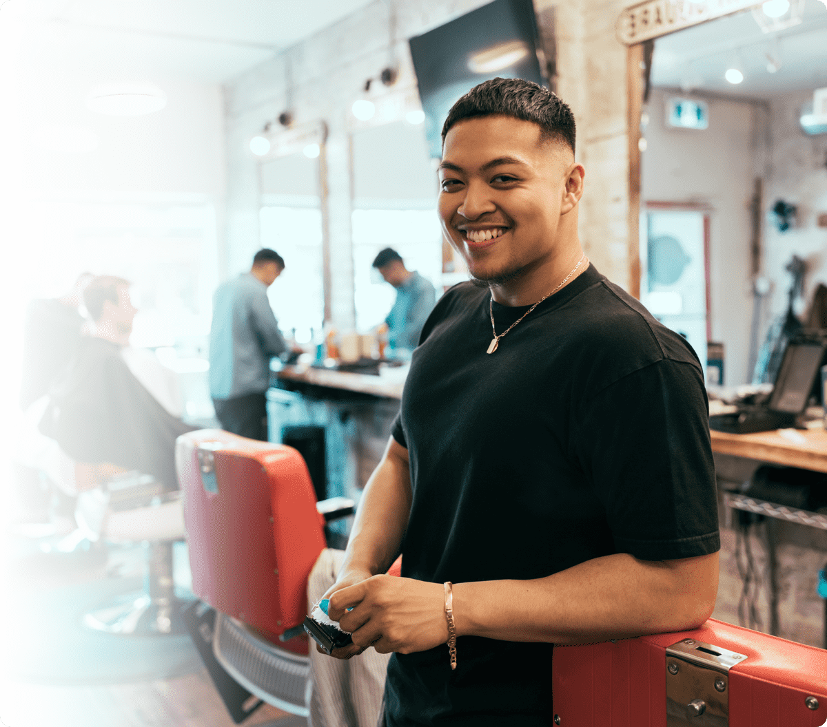 A man smiling after a haircut