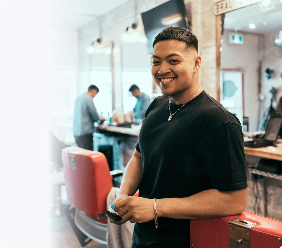Setmore barber client standing and smiling at the camera