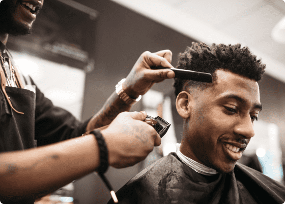 A barber giving his client a haircut