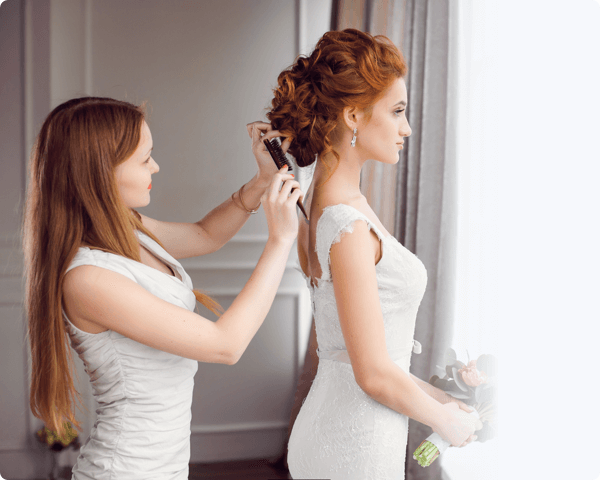 A bride getting her hair done on her wedding day