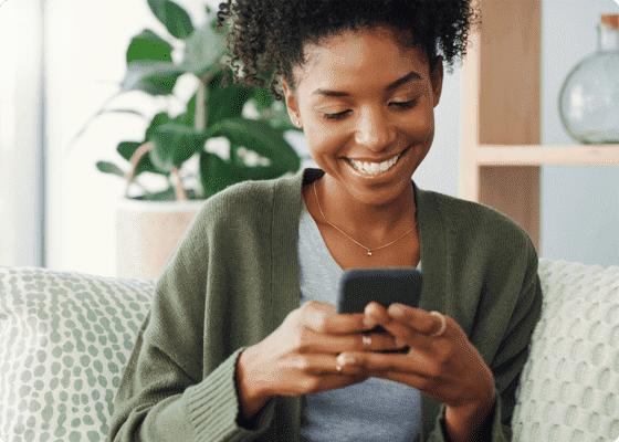Setmore customer smiling look at phone