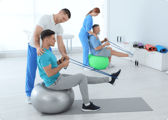 Trainer and trainee working out for leg in a room