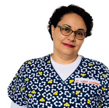A medical professional smiling